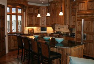 Country Kitchen with Breakfast bar, gas range, Soapstone counters, Pendant light, Inset cabinets, Subway Tile, Glass panel
