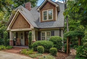 Craftsman Exterior of Home with Arbor, Fence, Glass panel door, Pathway