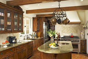 Mediterranean Kitchen with Complex granite counters, Farmhouse sink, L-shaped, Limestone Tile, Undermount sink, Glass panel