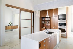 Contemporary Kitchen with Concrete tile , Kitchen island, Pendant light, Shoji door, can lights, Corian counters, dishwasher