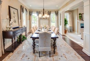 Traditional Dining Room with double-hung window, Standard height, Pendant light, Chair rail, Hardwood floors, Crown molding