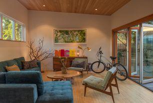 Modern Living Room with Hardwood floors, Standard height, Casement, can lights, folding door