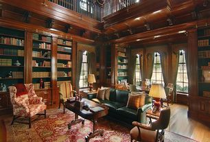 Traditional Living Room with Window seat, Built-in bookshelf, Crown molding, Heriz Rug, Cathedral ceiling, Hardwood floors