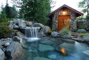 Rustic Landscape/Yard with Natural rock pool accents, Pond, Pathway, Fountain, Waterfall feature, Garden shed, Barn door