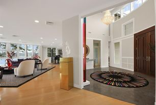 Contemporary Entryway with Cathedral ceiling, Chandelier, French doors, Concrete floors