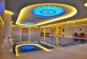 Mediterranean Swimming Pool with exterior stone floors, Indoor pool