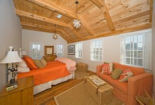 Cottage Guest Bedroom with High ceiling, Crown molding, Exposed beam, Superior moravian star hanging light, Hardwood floors