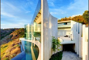 Contemporary Swimming Pool with Concrete floors, exterior stone floors, picture window, Infinity pool