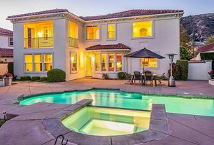 Mediterranean Swimming Pool with Raised beds, exterior stone floors, French doors, Fence, Pathway, Pool with hot tub