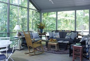Cottage Porch with Screened porch, Track lighting, Painted wood panel ceiling, Wood deck flooring, Rocking chair, Area rug