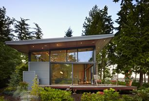 Contemporary Exterior of Home with Pathway, sliding glass door, Outdoor kitchen, picture window