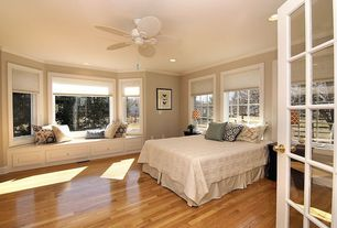 Traditional Guest Bedroom with Hardwood floors, Bay window, Crown molding, can lights, Ceiling fan, Standard height, Casement