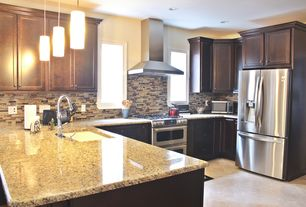 Traditional Kitchen with Ms international amber yellow granite, Undermount sink, Pendant light, limestone tile floors