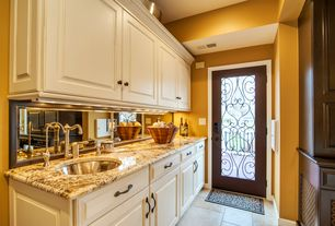 Traditional Kitchen with limestone tile floors, Undermount sink, High ceiling, One-wall, Raised panel, Flush, flush light