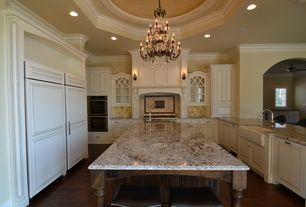 Traditional Kitchen with Custom hood, Breakfast bar, Farmhouse sink, Glass panel, Kitchen island, Crown molding, High ceiling