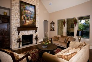 "Mediterranean Living Room with Hardwood floors, Flambeau lighting teche 36"" h table lamp with empire shade, stone fireplace"