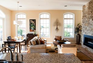 Contemporary Living Room with Standard height, Arched window, double-hung window, can lights, stone fireplace, Fireplace