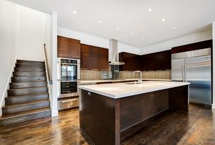 Modern Kitchen with Kitchen island, L-shaped, Wall Hood, Undermount sink, European Cabinets, double wall oven, can lights