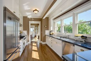 Traditional Kitchen with Simple granite counters, Subway Tile, Hardwood flooring, Flat panel cabinets, Galley, Crown molding