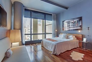 Contemporary Master Bedroom with High ceiling, Wall sconce, Exposed beam, Columns, picture window, Hardwood floors