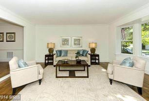 Traditional Living Room with Standard height, Bay window, Hardwood floors, Sunken living room, Crown molding