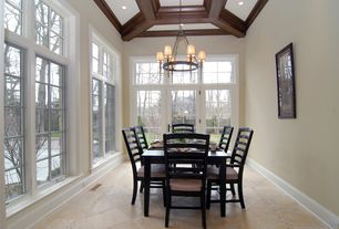 Traditional Dining Room with limestone tile floors, Crown molding, Exposed beam, French doors, Chandelier, Transom window