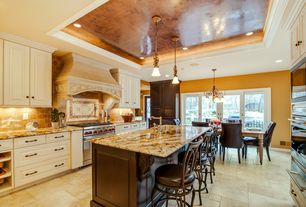 Traditional Kitchen with Crown molding, Breakfast nook, Limestone Tile, Stone Tile, Flush, U-shaped, Raised panel