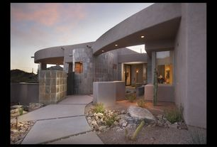 Modern Entryway with sliding glass door, Kichler landscape led pathway light, Exterior stucco walls, Standard height