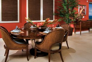 Tropical Dining Room with Standard height, Crown molding, sandstone floors