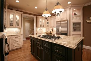 Country Kitchen with Raised panel, U-shaped, Inset cabinets, Crown molding, Complex granite counters, Kitchen island