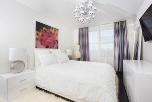 Contemporary Master Bedroom with Standard height, Hardwood floors, Chandelier, double-hung window