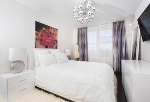 Contemporary Master Bedroom with Chandelier, Hardwood floors