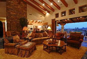 Mediterranean Great Room with slate tile floors, Carpet, High ceiling, Columns, Chandelier, stone fireplace, Exposed beam
