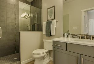 Modern 3/4 Bathroom with Ceramic Tile, frameless showerdoor, Flat panel cabinets, full backsplash, Corian counters, Flush