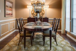 Traditional Dining Room with Wainscotting, Chair rail, Chandelier, Standard height, Hardwood floors