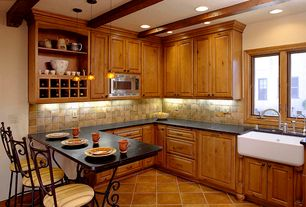 Eclectic Kitchen with full backsplash, Stone Tile, stone tile floors, Slate Tile, can lights, Standard height, Farmhouse sink