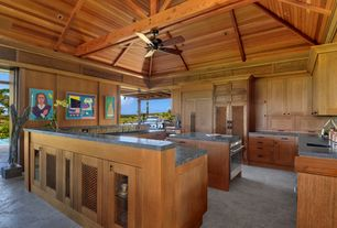 Tropical Kitchen with Undermount sink, U-shaped, Ceiling fan, Exposed beam, High ceiling, Slate counters, European Cabinets