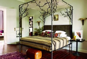 Eclectic Guest Bedroom with Crown molding, Anthropologie - forest canopy bed, Hardwood floors, Chandra - celecot area rug