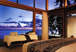 Tropical Master Bedroom with Yanuca island, fiji, Natural light, Transom window, Ocean view, limestone tile floors, Spa