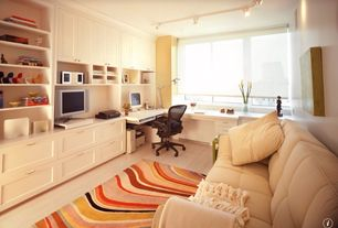 Traditional Home Office with Crown molding, specialty window, Paint, Built-in bookshelf, Standard height, Laminate floors