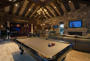 Rustic Game Room with Ceiling fan, Chandelier, High ceiling, Exposed beam, slate floors