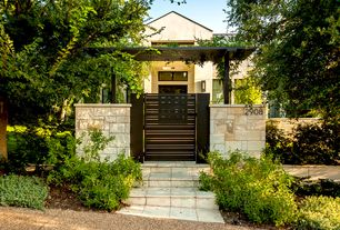 Contemporary Front of Home with exterior stone tile floors, Exterior stucco walls, Trellis, Steel gate and pagoda top trellis