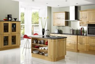 Modern Kitchen with large ceramic tile floors, Wall Hood, Flush, Glass panel, electric cooktop, French doors, L-shaped