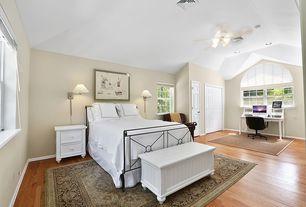 Traditional Guest Bedroom with Arched window, Ceiling fan, Hardwood floors, specialty door, Built-in bookshelf