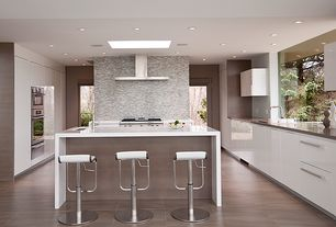 Modern Kitchen with Breakfast bar, Flush, Skylight, Soapstone counters, French doors, Undermount sink, Waterfall countertop