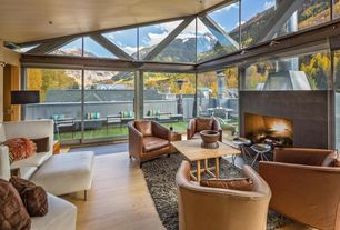 Contemporary Living Room with Cement fireplace, Hardwood floors, High ceiling, Transom window