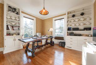 Traditional Home Office with interior wallpaper, Pendant light, Built-in bookshelf, Hardwood floors, Crown molding