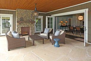Craftsman Porch with Flat stone patio, French doors, exterior stone floors, Ricker rock fireplace facade, Screened porch