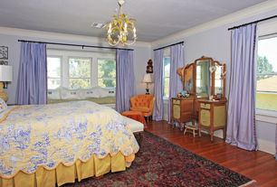 Traditional Master Bedroom with double-hung window, Chandelier, Standard height, Hardwood floors, Crown molding