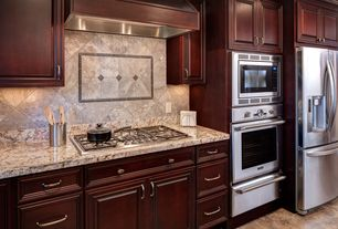 Traditional Kitchen with Complex granite counters, limestone tile floors, Flat panel cabinets, One-wall, Stone Tile